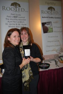 Dr. Whitney and Dr. Kerri show off their new PCOS tea at the Bridal Show.